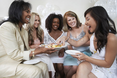 Friends : Smiling group of women enjoying bridal shower