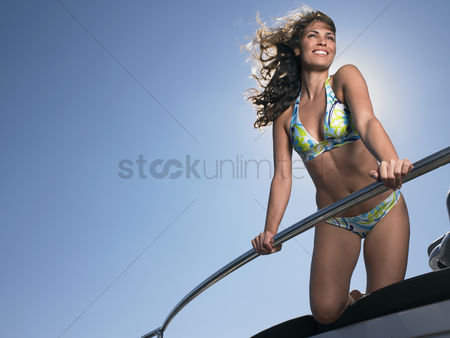 Blank : Smiling woman on boat