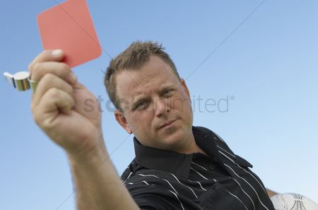 Pitch : Soccer referee showing red card