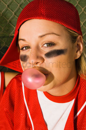 Blowing : Softball player blowing bubblegum portrait