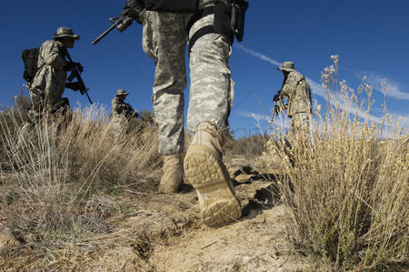 Grass : Soldiers walking in desert low section