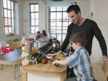 Husband : Son helping father in kitchen