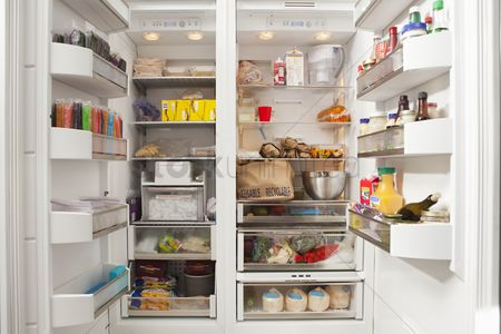 Cold : Stacked products in open fridge