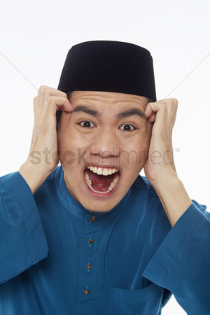 Baju melayu : Stressed man touching his forehead