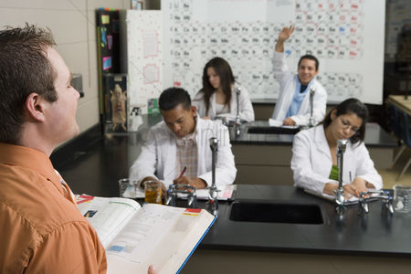 Instruction : Student raising hand in science class