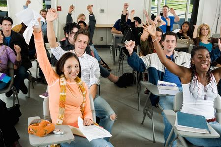 High school : Students raising hands in classroom