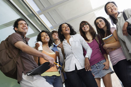 Teacher : Students smiling in hallway at school low angle view