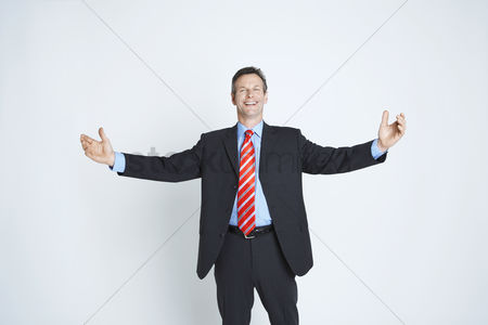 Arm raised : Studio portrait of businessman with arms outstretched