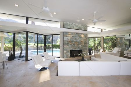 Interior : Sunken seating area and exposed stone fireplace of palm springs home