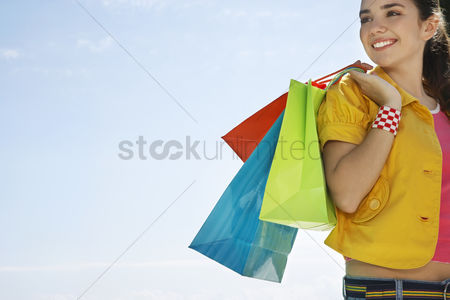 Fashion : Teenage girl carrying shopping bags outdoors