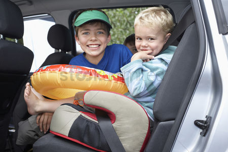 Interior background : Three boys  3-11  in car portrait