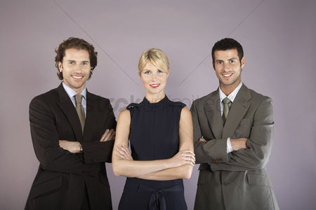 Group portrait : Three business people with arms crossed portrait