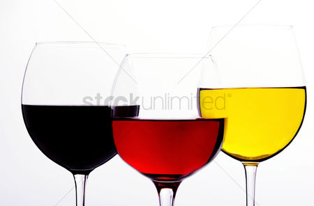 Refreshment : Three colours of drinks in wine glasses