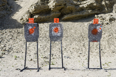 Firing : Three targets with bullet holes at firing range