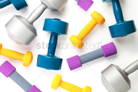 Workout : Top view of dumbbells on white background with copy space