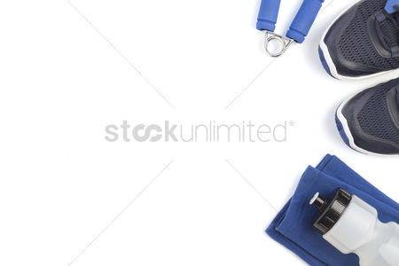 Fitness : Top view of fitness equipment on white background with copyspace