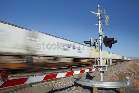 Transportation : Train passing level crossing motion blur