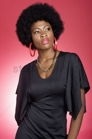 Curly hair : Trendy young african american woman over colored background