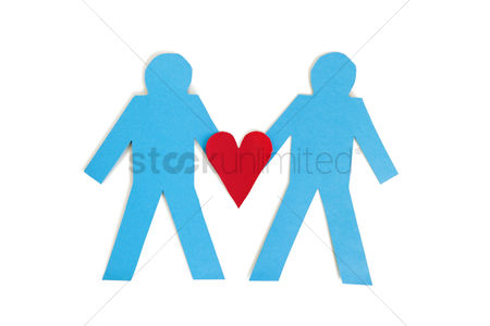 Ideas : Two blue stick figures holding a red heart over white background