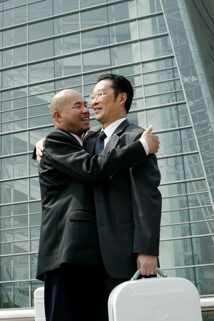 Ritual : Two businessmen hugging each other