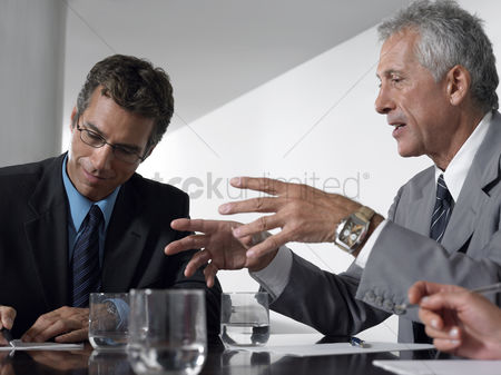 Leadership : Two businessmen in conference meeting