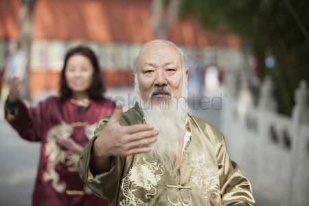 Forbidden : Two chinese people practicing tai ji