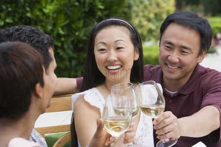 Toasting : Two couples toasting in garden
