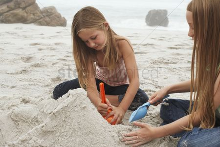 Pre teen : Two girls playing on beach
