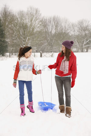 Gladness : Two girls walking in the snow