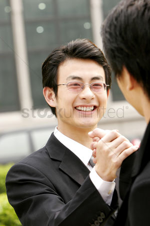 Bespectacled : Two men greeting in each other