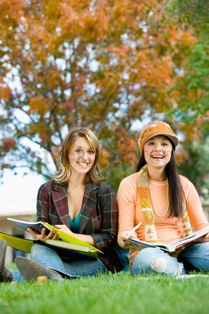 University : Two students studying outdoors  portrait