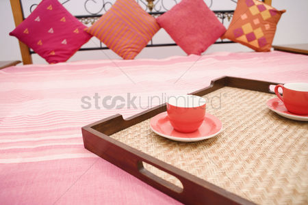 Diwali : Two tea cups in a tray on the bed