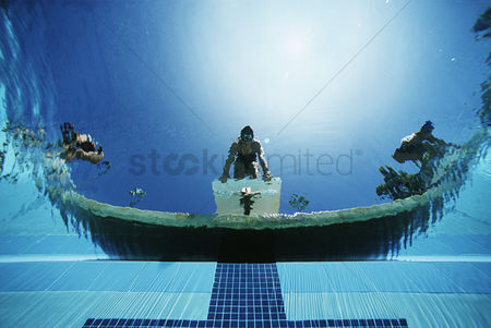 Diving : Underwater view of swimmers on diving boards