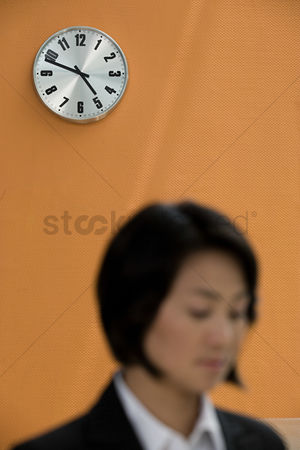 Interior : Wall clock and a businesswoman
