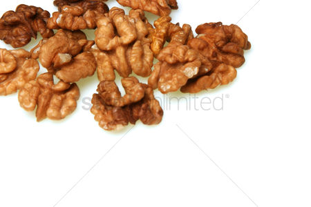 Mature : Walnuts on whote background - studio shot