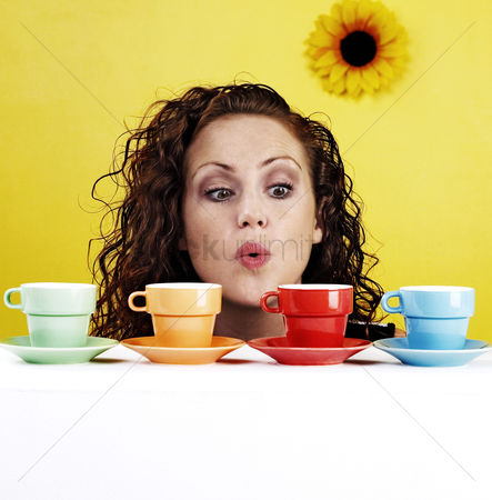 Sunny : Woman blowing her cups of coffee