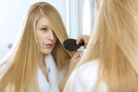 Smile : Woman brushing hair