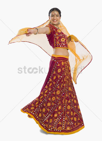 Dance : Woman dancing in bright red lehenga choli