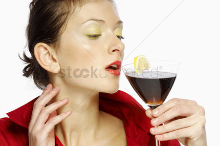 Celebrating : Woman drinking a glass of red wine