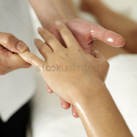 Resting : Woman enjoying a hand massage