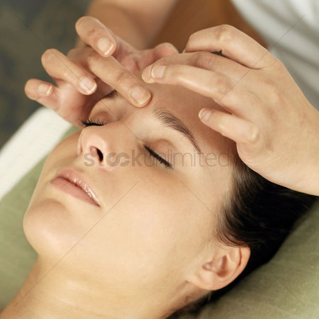 People : Woman enjoying a head massage