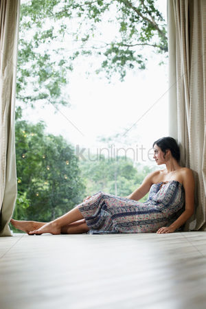 Window : Woman enjoying the outdoor view from the glass window