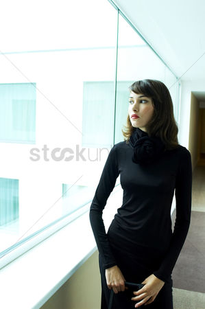 Daydream : Woman enjoying the view from the glass window