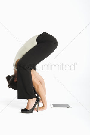 Ponytail : Woman exercising with tablet pc on side
