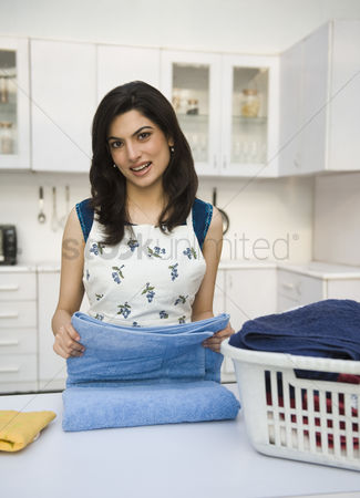 Housewife : Woman folding laundry