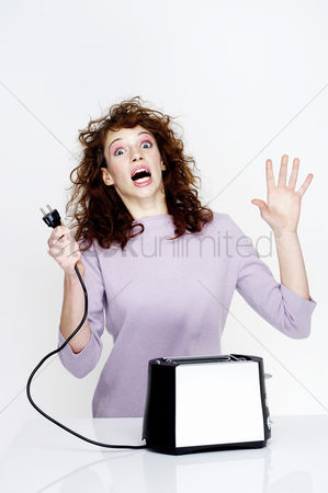 Pain : Woman getting an electric shock