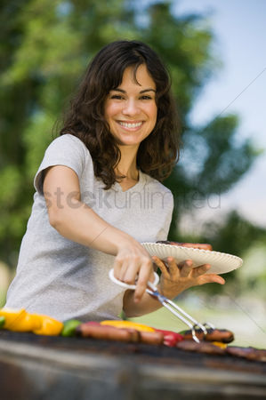 Hot dog : Woman grilling food at park portrait