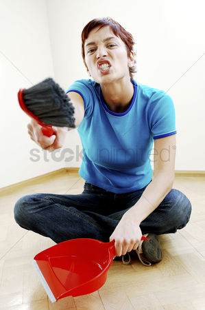 Tidy : Woman holding a brush and dustpan