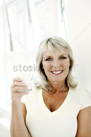 Satisfying : Woman holding a glass of milk