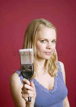 Paint brush : Woman holding a paint brush